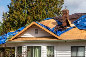 Home being repaired by gold standard restorations the best roofers in crystal lake illinois