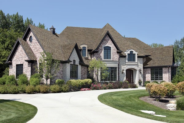 Beautiful brick home with grey tamko roofing shingles from gold standard restorations the best roofers in mchenry using tamko roofing products