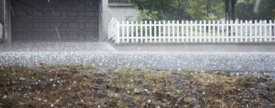 Hail storm and ice gathers inthe street by gold standard restorations the best roofers in island lake illinois