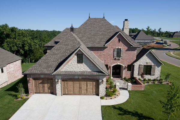 House with a beautiful grey roof using shingles from tamko from gold standard restorations the best roofers in woodstock using tamko roofing products