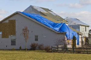 House with damaged roof siding and gutter after storm from gold standard restorations the best roofer in hoffman estates for 24/7 emergency services - hoffman estates, schaumburg, elk grove village, des plaines, chicago, illinois