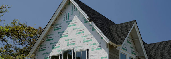 Hardie weather wrap on home before siding is done from gold standard restorations