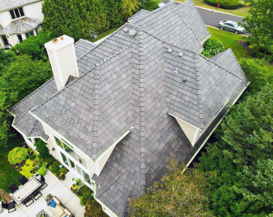 View of homes roof done with da vinci shingles from birds eye from gold standard restorations the best roofers in elgin